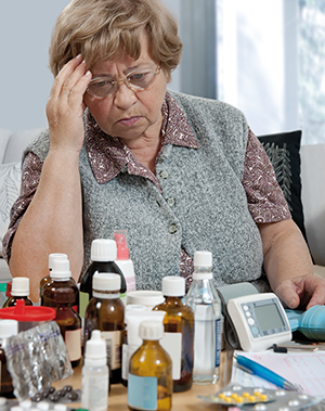 senior woman with the medicine bottles